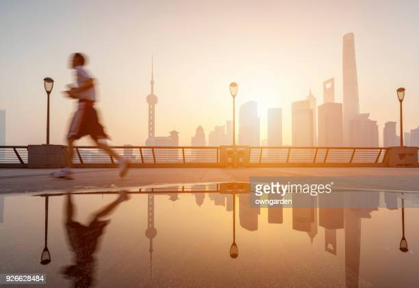 One young man running in the bund