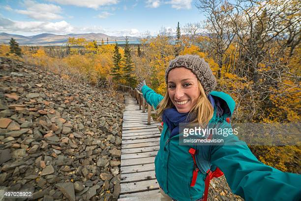 One young woman taking selfie in nature while hiking