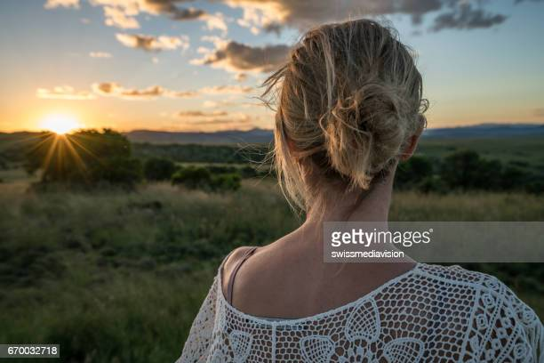 One young woman watching sunset in national park
