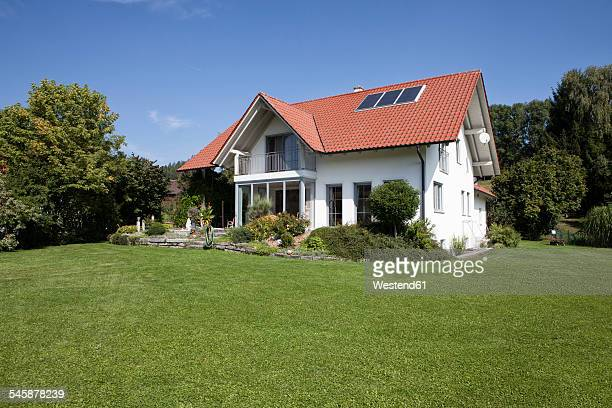 one-family house with garden - house stock pictures, royalty-free photos & images