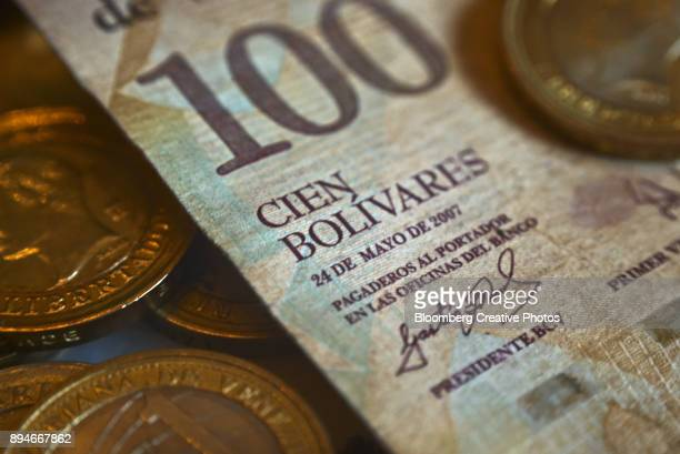 a one-hundred bolivar note - venezuelan bolívar currency stock pictures, royalty-free photos & images