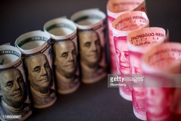 US onehundred dollar banknotes and Chinese onehundred yuan banknotes are arranged for a photograph in Hong Kong China on Monday April 15 2019 China's...
