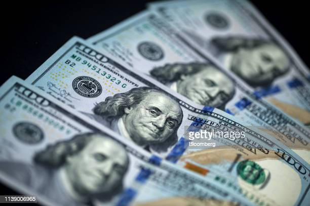 One-hundred dollar banknotes are arranged for a photograph in Hong Kong, China, on Monday, April 15, 2019. China's holdings of Treasury securities...