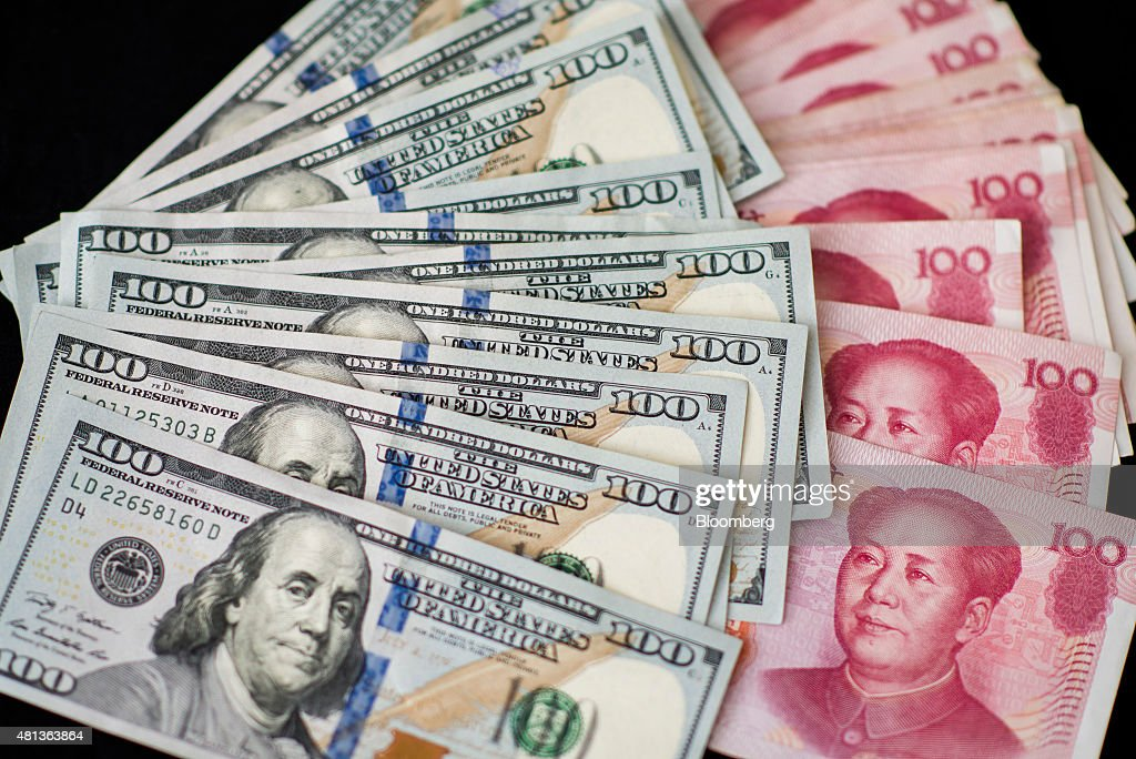 Yuan And Dollar Banknotes Ahead Of Tenth Anniversary Of China's Yuan Reform : News Photo