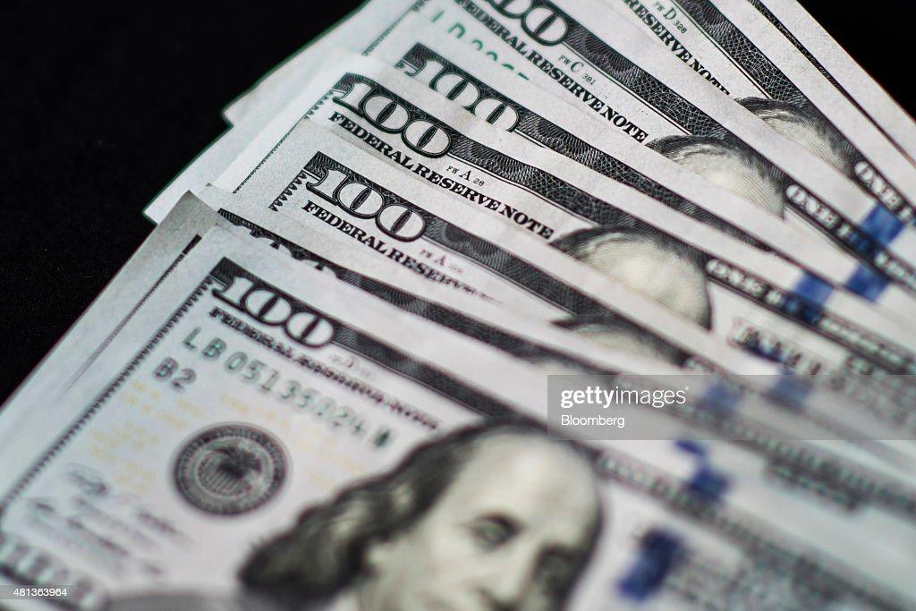 Yuan And Dollar Banknotes Ahead Of Tenth Anniversary Of China's Yuan Reform : News Photo