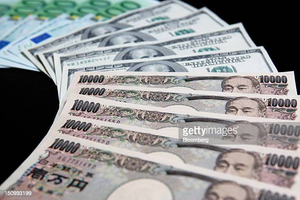 Onehundred euro from top US onehundred dollar and tenthousand yen banknotes are arranged for a photograph in Soka City Saitama Prefecture Japan on...