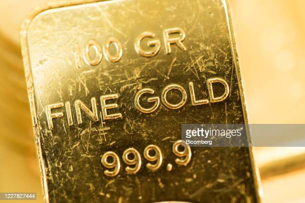One-hundred gram gold bar sits at Gold Investments Ltd. Bullion dealers in this arranged photograph in London, U.K., on Wednesday, July 29, 2020....