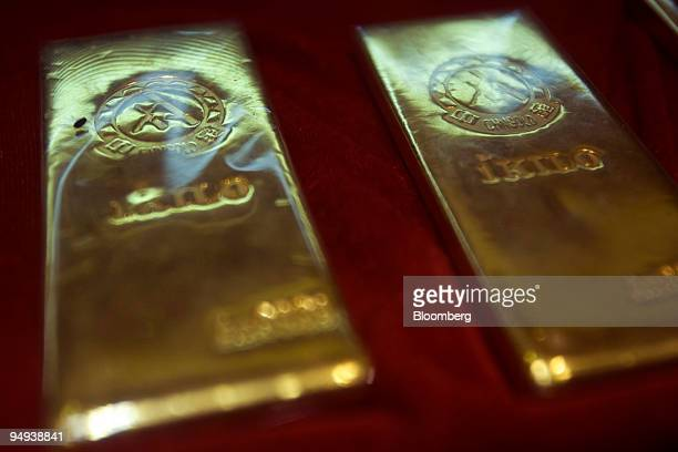 Onekilogram gold bars are displayed at a department store specializing in precious metals and stones in Beijing China on Saturday April 12 2009 A...