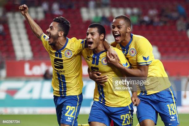 Onel Hernandez of Braunschweig celebrates his team's first goal with team mates Salim Khelifi and Louis Samson during the Second Bundesliga match...