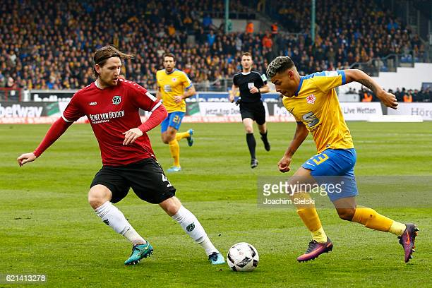 Onel Hernandez of Braunschweig challenges Stefan Strandberg of Hannover during the Second Bundesliga match between Eintracht Braunschweig and...