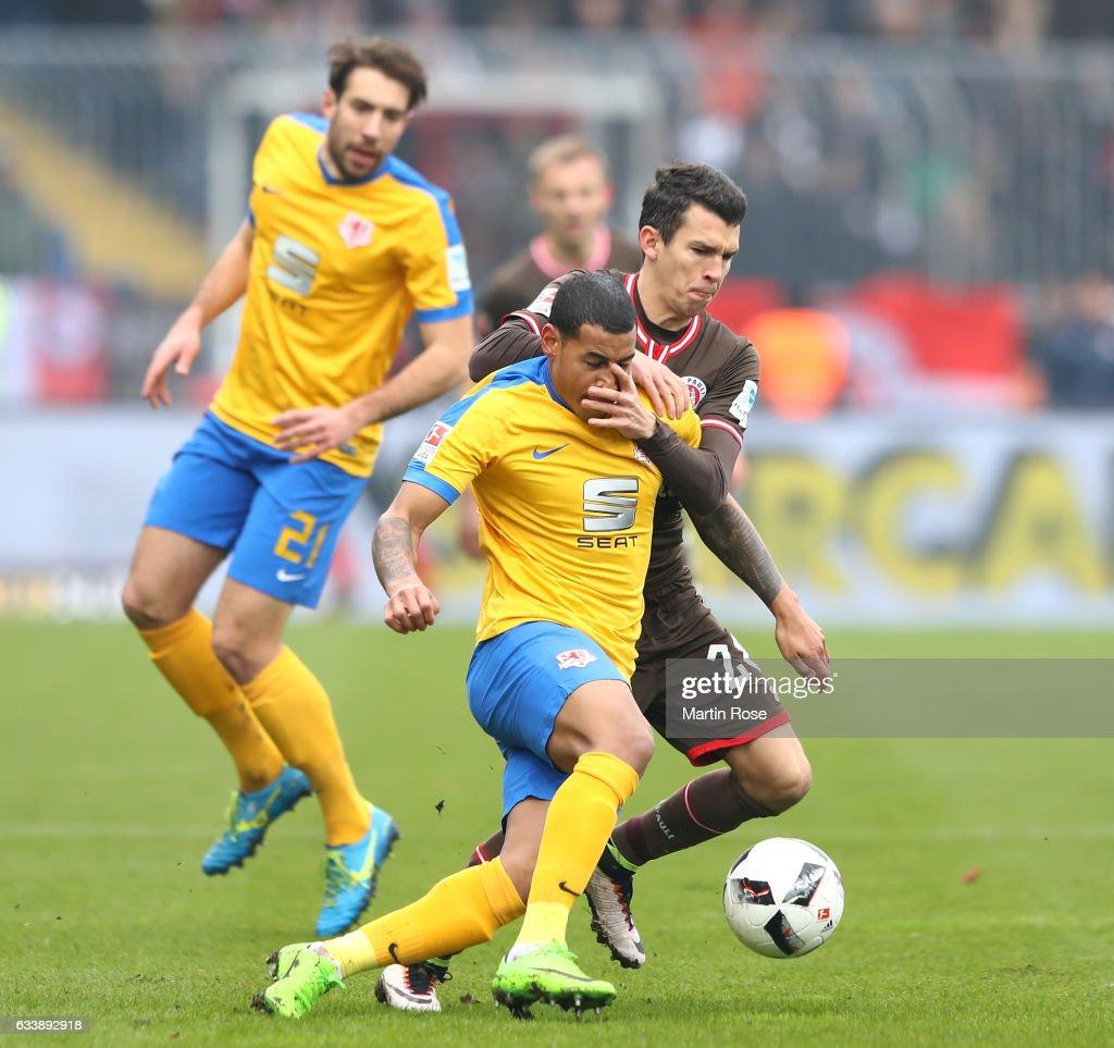 Onel Hernandez of Braunschweig is challenged by Johannes Flum of St. Pauli during the Second Bundesliga match between Eintracht Braunschweig and FC St. Pauli at Eintracht Stadion on February 5, 2017 in Braunschweig, Germany.