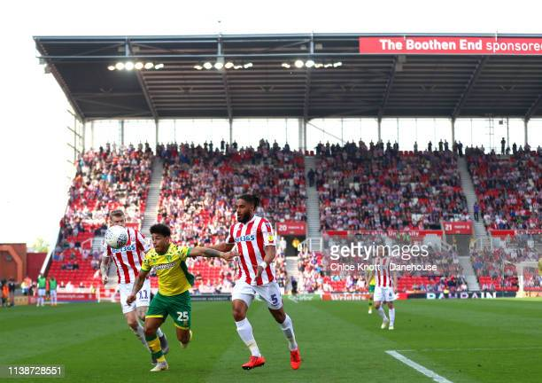 Onel Hernandez of Norwich City and James McClean and Ashley Williams of Stoke City in action during the Sky Bet Championship match between Stoke City...