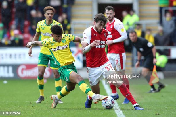 Onel Hernandez of Norwich City tackles Matt Crooks of Rotherham United at The New York Stadium on March 16 2019 in Rotherham England
