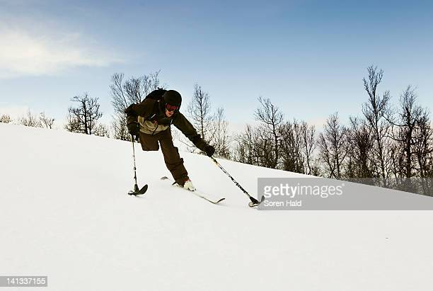 One-legged skier snowy slope