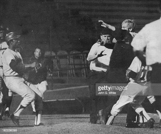 SEP 1 1970 SEP 4 1970 OneMan Rhubarb at Bears Finale Oklahoma City's Rich Chiles is restrained by umpires as he tries to get at Denver pitcher Doug...
