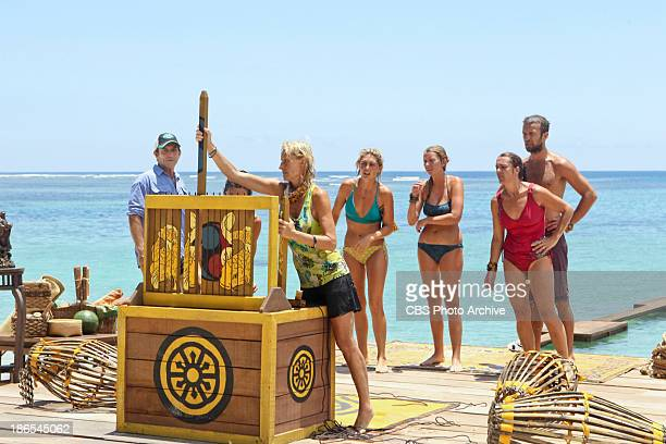 """OneMan Wrecking Ball """" Jeff Probst watches as Tina Wesson attempts to solve the puzzle portion of the Immunity Challenge during the sixth episode of..."""