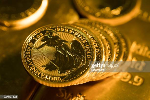 One-ounce Britannia gold coins sit stacked together at Gold Investments Ltd. Bullion dealers in this arranged photograph in London, U.K., on...