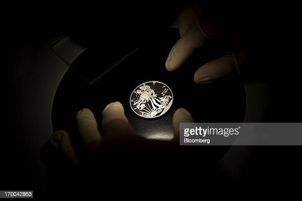 A oneounce silver bullion coin is inspected under a microscope at the United States Mint at West Point in West Point New York US on Wednesday June 5...