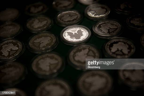 Oneounce Silver bullion coins are displayed in a tray at the United States Mint at West Point in West Point New York US on Wednesday June 5 2013...