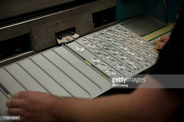 Oneounce silver bullion coins come off a press at the United States Mint at West Point in West Point New York US on Wednesday June 5 2013 Sales of...