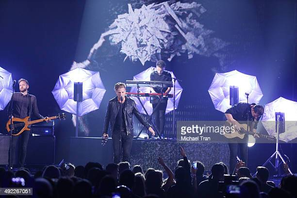 OneRepublic perform onstage during the 2014 Billboard Music Awards held at MGM Grand Garden Arena on May 18, 2014 in Las Vegas, Nevada.