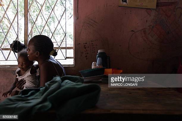 M Onesime looks after her son in the house she shares with 26 other people in Port Louis Mauritius 17 January 2005 The Onesime family originally from...