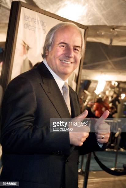 Onetime fugitive Frank Abagnale gives a thumbs up as he arrives for the premiere of the film Catch Me If You Can 16 December 2002 in the Westwood...