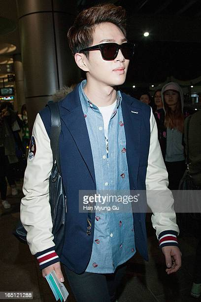 Onew of South Korean boy band SHINee is seen upon arrival from Japan at Gimpo International Airport on March 30 2013 in Seoul South Korea