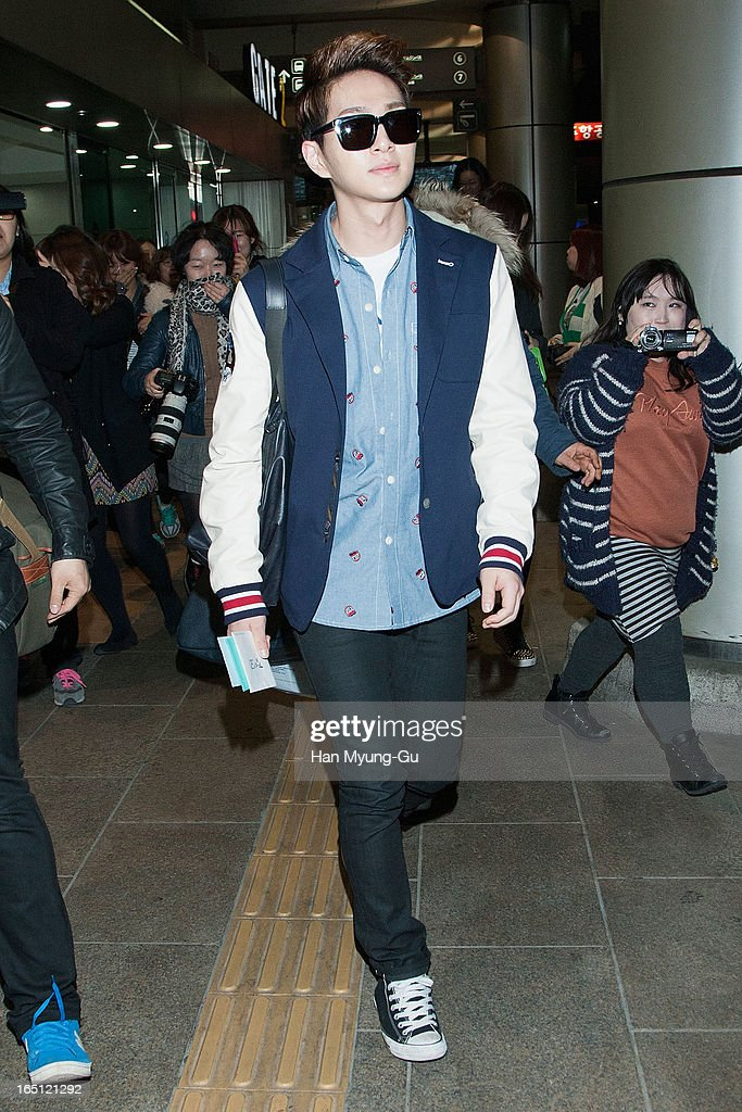 Onew of South Korean boy band SHINee is seen upon arrival from Japan at Gimpo International Airport on March 30, 2013 in Seoul, South Korea.