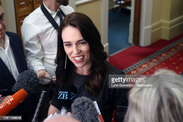 ONew Zealand Prime Minister Jacinda Ardern smiles as she talks to press gallery reporters on October 20, 2020 in Wellington, New Zealand. Labour's...
