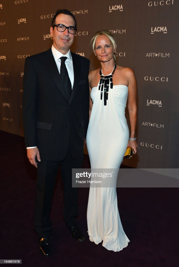 OneWest Bank CEO Steven Mnuchin and Heather Mnuchin arrive at LACMA 2012 Art + Film Gala Honoring Ed Ruscha and Stanley Kubrick presented by Gucci at LACMA on October 27, 2012 in Los Angeles, California.