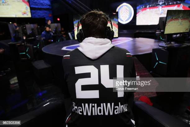 Mama Im Dat Man of Blazer5 Gaming hugs Vert of Warriors Gaming Squad after the match between the two teams on June 23 2018 at the NBA 2K League...