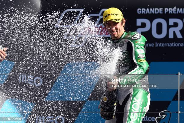 Onexox TKKR SAG Team's Australian rider Remy Gardner celebrates on the podium after winning the Moto2 race of the Portuguese Grand Prix at the...