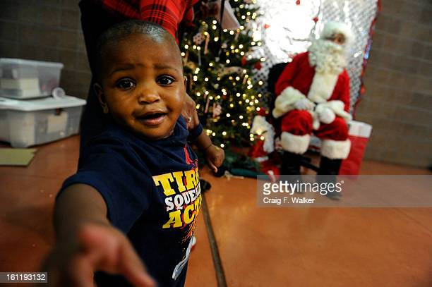 Oneyearold Da'Juan Bridges prepares to visit Santa during Delta Eta Boule's Toys For Tots Christmas Celebration at the Hiawatha Davis Recreation...