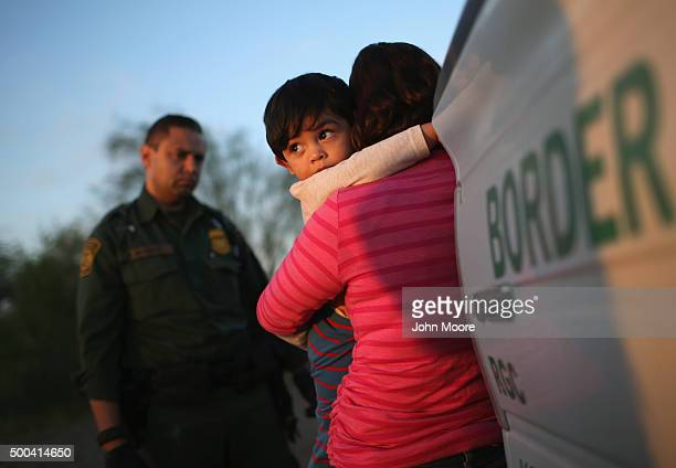A oneyearold from El Salvador clings to his mother after she turned themselves in to Border Patrol agents on December 7 2015 near Rio Grande City...