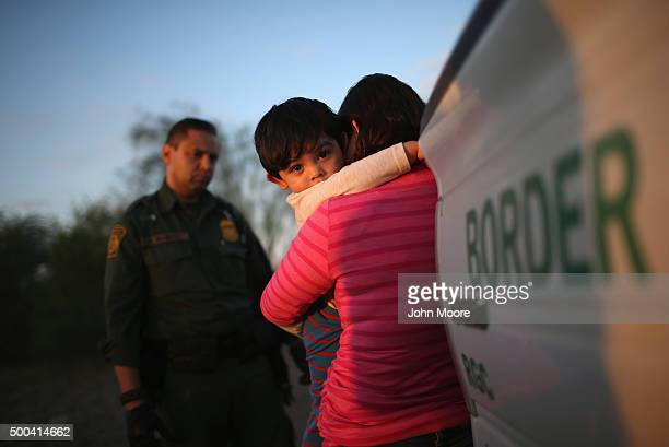 One-year-old from El Salvador clings to his mother after she turned themselves in to Border Patrol agents on December 7, 2015 near Rio Grande City,...