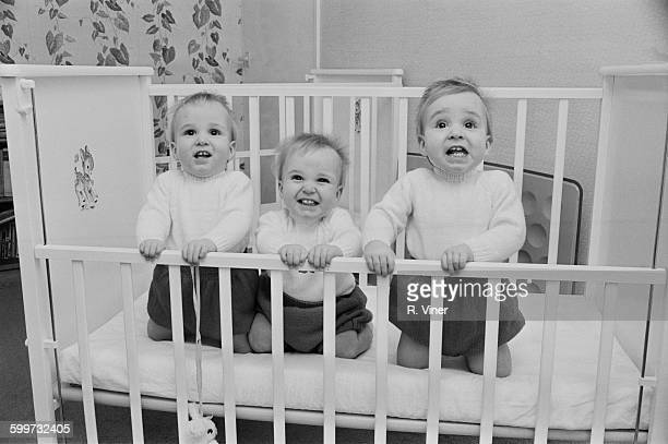 One-year-old identical triplets, Guy, Simon and Oliver Turley, UK, 3rd December 1967.