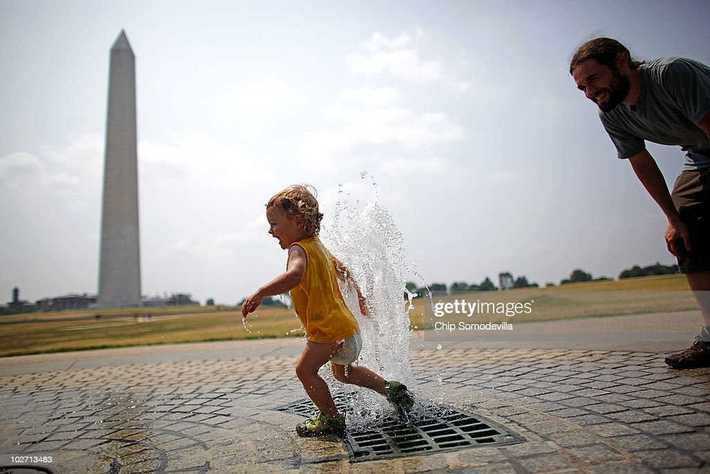 One-year-old Lukas Brumos Karrass of Raliegh, North Carolina, runs through a jet of water near the Washington Monument on the National Mall July 8, 2010 in Washington, United States. Temperatures on the East Coast reached the mid-90s by midday on Thursday, showing a break in the 100-degree days from earlier in the week.