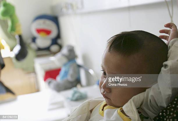 Oneyearold Wei Wei a young child with three legs and both female male reproductive organs cries after he undergoes a further examination at the...