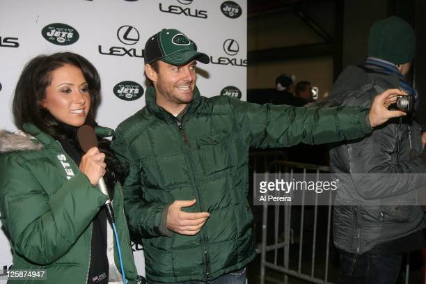 On-Field Hostess Jenn Sterger of the New York Jets conducts a pregame interview with actor Will Forte before the Denver Broncos vs New York Jets game...