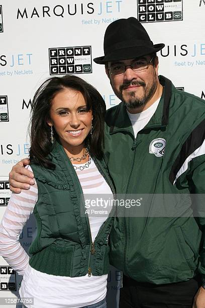 On-field Hostess Jenn Sterger of the New York Jets conducts an interview with Actor David Zayas at the St. Louis Rams vs New York Jets game at Giants...