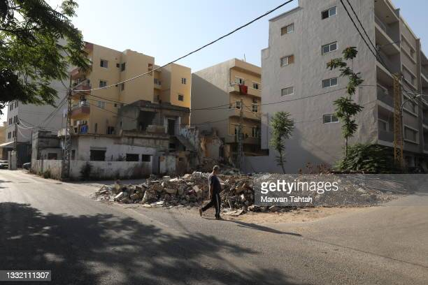 Ongoing construction work and daily life in the Karantina neighbourhood closest to the port and badly damaged during the blast on August 03, 2021 in...