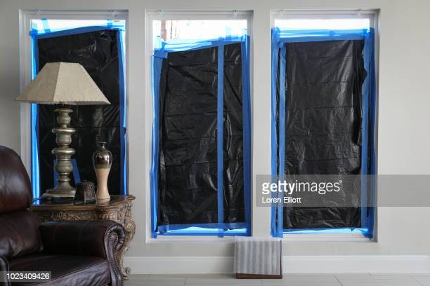Ongoing repairs resulting from Hurricane Harvey are pictured inside a home in the Meyerland neighborhood on August 25 2018 in Houston Texas August 25...