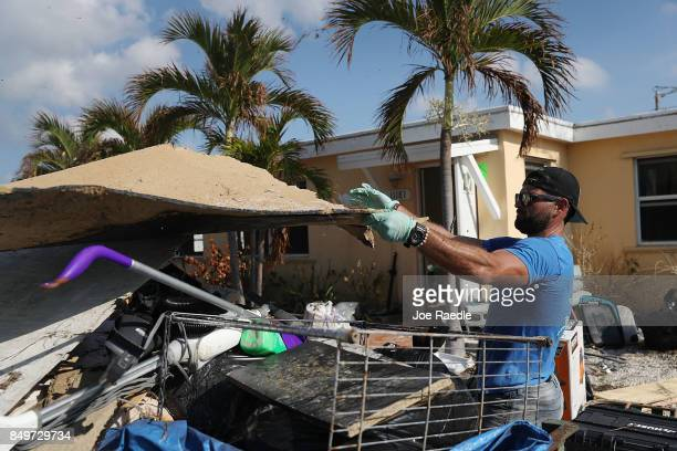 Oni Ferreiro III throws items out as he cleans up his home after it was badly damaged by hurricane Irma on September 19 2017 in Marathon Florida The...