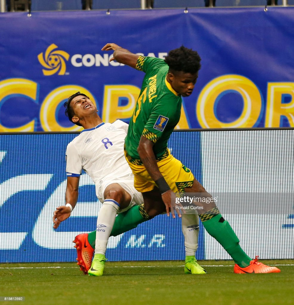 Oniel Fisher #8 of Jamaica takes down Denis Pineda of El Salvador during the 2017 CONCACAF Gold Cup at Alamodome on July 16, 2017 in San Antonio,Texas.