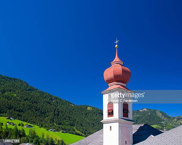 Onion dome church in village of Ortisei, Val Gardena, Dolomites.