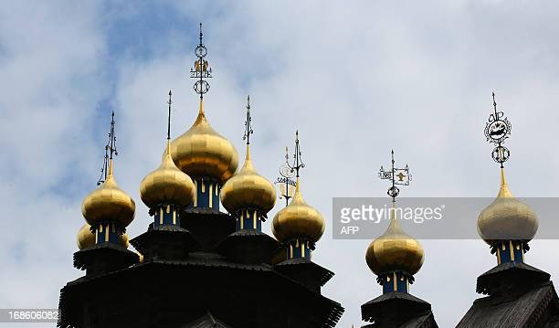 Onion domes of the 'GlockenPalast' are pictured in Gifhorn northern Germany on May 11 2013 The Bells palace has been completed after 16 years of...