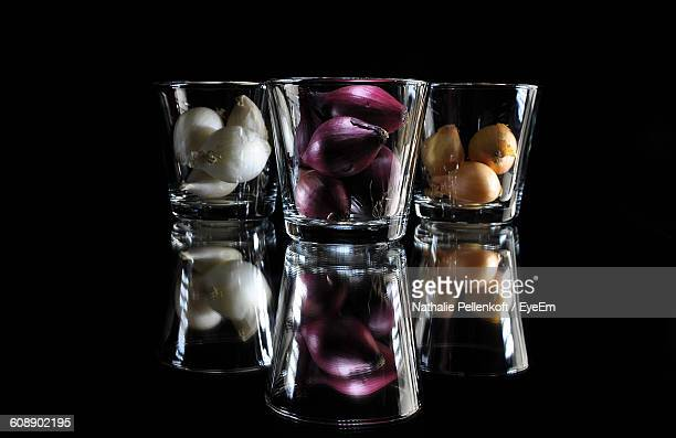 onions in glass on black background - nathalie pellenkoft stock pictures, royalty-free photos & images