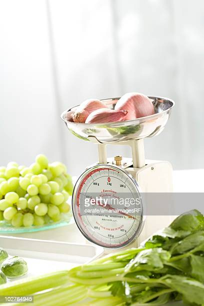 Onions on a kitchen weight scale