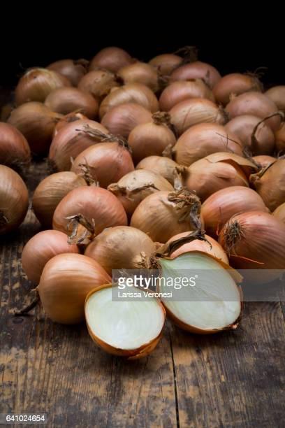 onions on dark wood